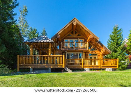 Beautiful modern log house in the mountains in canada stock photo