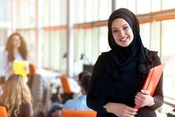 beautiful modern Muslim businesswoman portrait in office