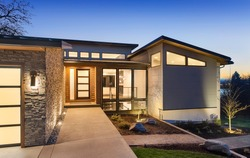 Beautiful modern style luxury home at sunset, featuring entrance and elegant design