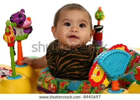 Beautiful 3 month Hispanic baby playing with toys.