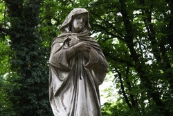 Beautiful monument to the old cemetery. Mourning, funeral and grief. Vintage landmark. Europe. Lviv, Ukraine.