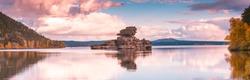 Beautiful morning landscape. Borovoe lake and stone sculprure Jumbaktas, Burabay National park in Northern Kazakhstan.