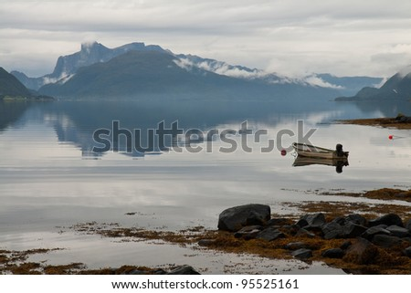 Beautiful morning landscape with a fog on the Norwegian fjord