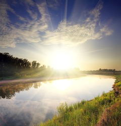 beautiful morning landscape with sunrise over river