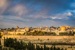 Beautiful morning light over the Old City of Jerusalem: Mount Zion, Jewish Quarter buildings, Hurva synagogue, the Temple Mount with Al Aqsa Mosque and Dome of the Rock; view from Mount of Olives