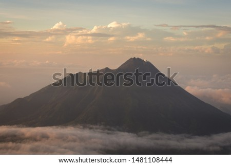 Beautiful morning on the peak of Mount Merbabu with Mount Merapi on the background. Mount Merbabu is one of the favorite climbing destinations and is very popular among travelers. #1481108444