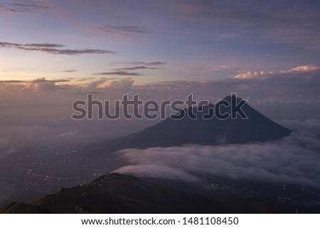 Beautiful morning on the peak of Mount Merbabu with Mount Merapi on the background. Mount Merbabu is one of the favorite climbing destinations and is very popular among travelers. #1481108450