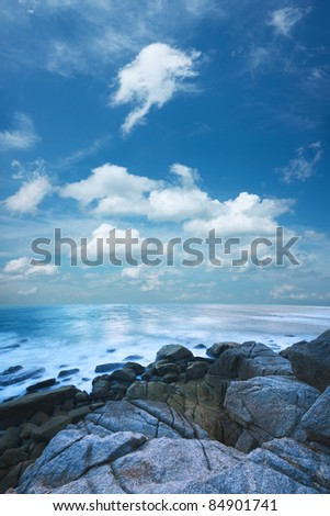 Beautiful morning sea scenery. Vertical composition, long exposure shot.