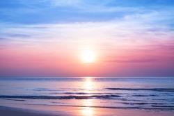 Beautiful morning sunrise, blue sea, pink sky, white clouds, yellow sun glow, golden reflection on water, peaceful landscape, quiet sunset on ocean beach, dawn seascape, Thailand, Koh Samui island