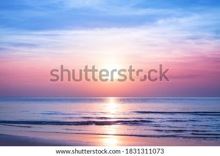 Beautiful morning sunrise, blue sea, pink sky, white clouds, yellow sun glow, golden reflection on water, peaceful landscape, quiet sunset on ocean beach, dawn seascape, Thailand, Koh Samui island 商業照片 ©