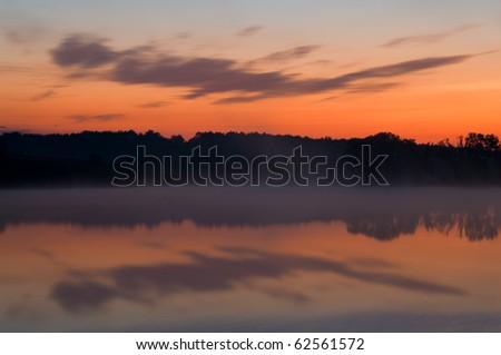 Beautiful morning with rising sun on lake