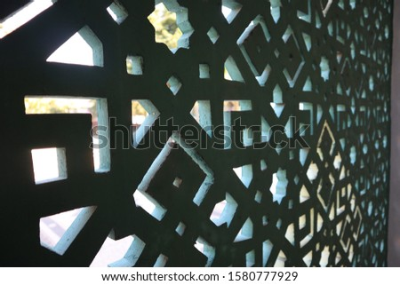 beautiful mosque building with charming caricatures and green