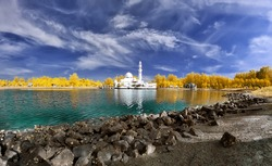 Beautiful mosque by the lakeside viewed in infrared