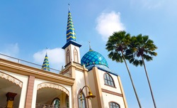 Beautiful mosque with palm trees. Can use for greeting ramadhan kareem or background