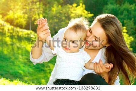Beautiful Mother And Baby outdoors Nature Beauty Mum and her Child playing in Park