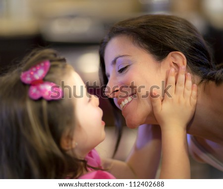 Beautiful mother and daughter share a tender moment