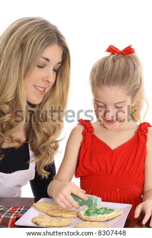 beautiful mother and daughter with cookies