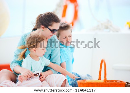 Beautiful mother and her kids having great time at luxury yacht