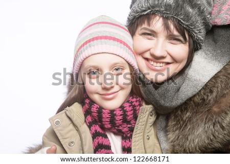 beautiful mother daughter winter portrait, studio shot