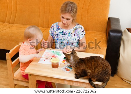 Beautiful mother with her child and cat