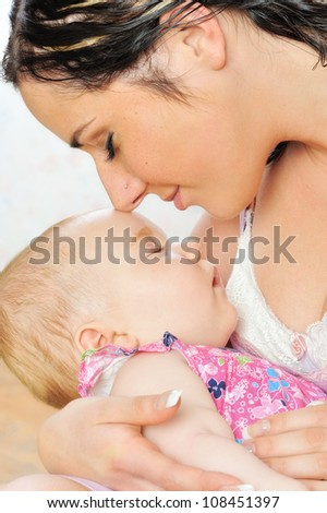 Beautiful mother with her newborn sleeping baby on the hands.