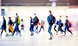 Beautiful motion blur of walking people. Early morning rush hours, busy modern life concept. Ideal for websites and magazines layouts
