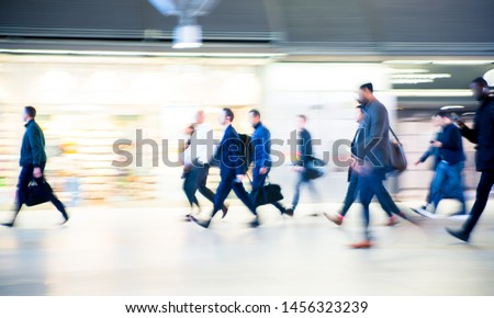 Beautiful motion blur of walking people. Early morning rush hours, busy modern life concept. Ideal for websites and magazines layouts #1456323239