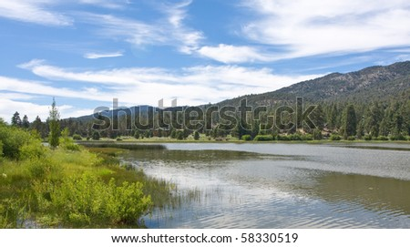 Beautiful mountain lake with clouds in the forrest