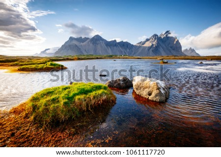 Beautiful mountain landscape on sunny day. Location Stokksnes cape, Vestrahorn (Batman Mount), Iceland, Europe. Wonderful image of amazing nature capture. Summer scene. Discover the beauty of earth.