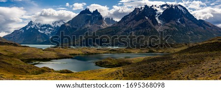 Photo of  Beautiful mountain landscape. Reflection of the mountains in the lake. Torres del Paine National Park, Chile.