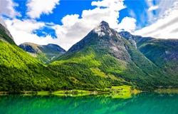 Beautiful mountain landscape. Summer green lake view