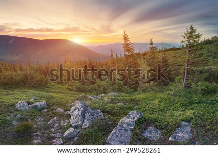 Beautiful mountain landscape with dramatic sky on sunset in Carpathian mountains