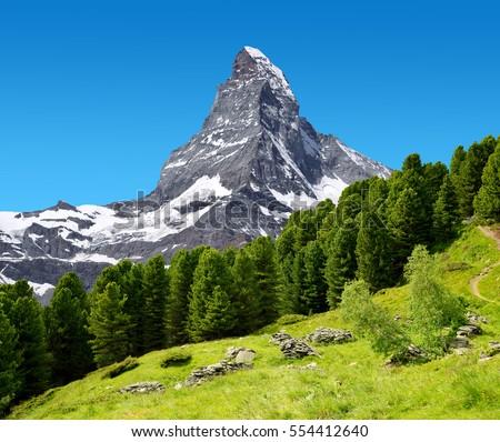 Stock Photo Beautiful mountain landscape with views of the Matterhorn peak in Pennine alps, Switzerland.