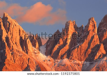 Beautiful mountain peaks covered by colored clouds at sunset, mountain landscape background #1192375801