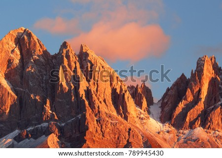 Beautiful mountain peaks covered by colored clouds at sunset, mountain landscape background #789945430