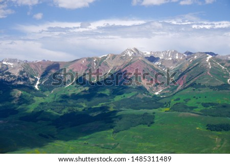 Beautiful Mountain Range Surrounding Crested Butte, CO.  Stunning and Rugged Mountain Peaks with Dynamic Green Valley Beneath.  Breathtaking and Colorful Mountain Range. #1485311489