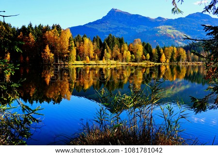 beautiful mountain reflections in a lake in autumn