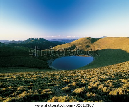 beautiful mountain scenery of lake and golden grassland in taiwan.