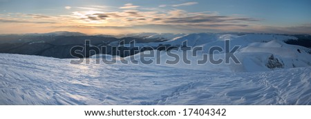 Beautiful mountain sunset landscape with sun way on ice-coated mountainside. (Ukraine, Carpathian Mt\'s, Svydovets Range) Three shots stitch image.