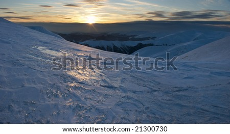 Beautiful mountain sunset landscape with sun way on ice-coated mountainside (Ukraine, Carpathian Mt\'s, Svydovets Range). Four shots stitch image.