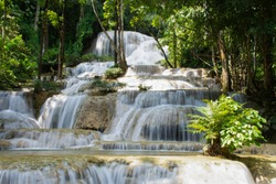 Beautiful mountain waterfall landscape in the nature autumn forest in north of Thailand. Maekae or Kaofu waterfall river scene.