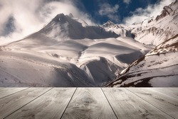beautiful mountains and empty wooden table in nature outdoor. Natural template landscape.