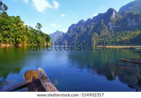 Beautiful mountains lake river sky and natural attractions in Rajjaprabha Dam at Khao Sok National Park, Surat Thani Province, Thailand.                               #554902357