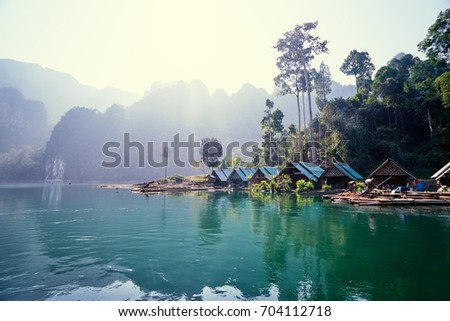 Beautiful mountains lake river sky and natural attractions in Ratchaprapha Dam at Khao Sok National Park, Surat Thani Province, Thailand. #704112718