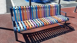beautiful multi-colored bench in city street