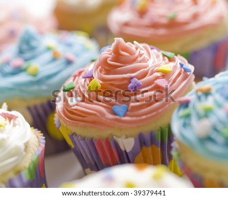 beautiful multi colored cupcake with shallow depth of field. Sweet dessert for a birthday.