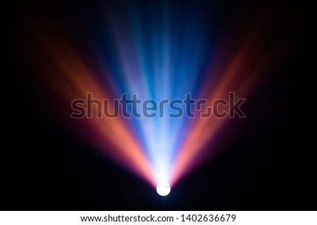 beautiful multicolor spotlight wide lens projector with light beam for film movie and cinema at night . abstract smoke texture . screening for multimedia with black background . #1402636679