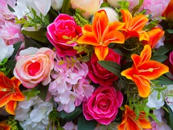 Beautiful multicolored  artificial flowers background
