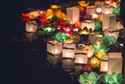 Beautiful Multicolored floating lanterns in the water in chinese or japanese style