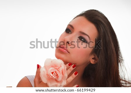 Beautiful multicultural young woman in a beauty studio portrait pose with a white background.